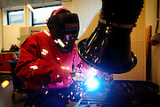 An inmate is learning welding skills during a workshop carried out inside the luxurious Halden Fengsel, (prison) near Oslo, Norway.