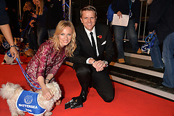 JAKE HUMPHREY and his wife HARRIET with a Battersea dog at Battersea Dogs & Cats Home's Collars & Coats Gala Ball held at Battersea Evolution, Battersea Park, London on30th October 2014.