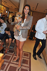 ALEX MEYERS and her dog Ribbons at a champagne breakfast hosted by Carolina Gonzalez-Bunster and TOD's in aid of the Walkabout Foundation held at TOD's, 2-5 Old Bond Street, London on 9th May 2013.