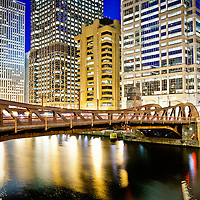 Chicago at night at Clark Street Bridge along the Chicago River with London Guarantee Building / Crain Communications Building (360 North Michigan) Unitrin / Kemper Building, Leo Burnett Building, 55 West Wacker building, and United Airlines building.
