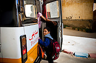 Mahmoud leaving early in the morning for school.