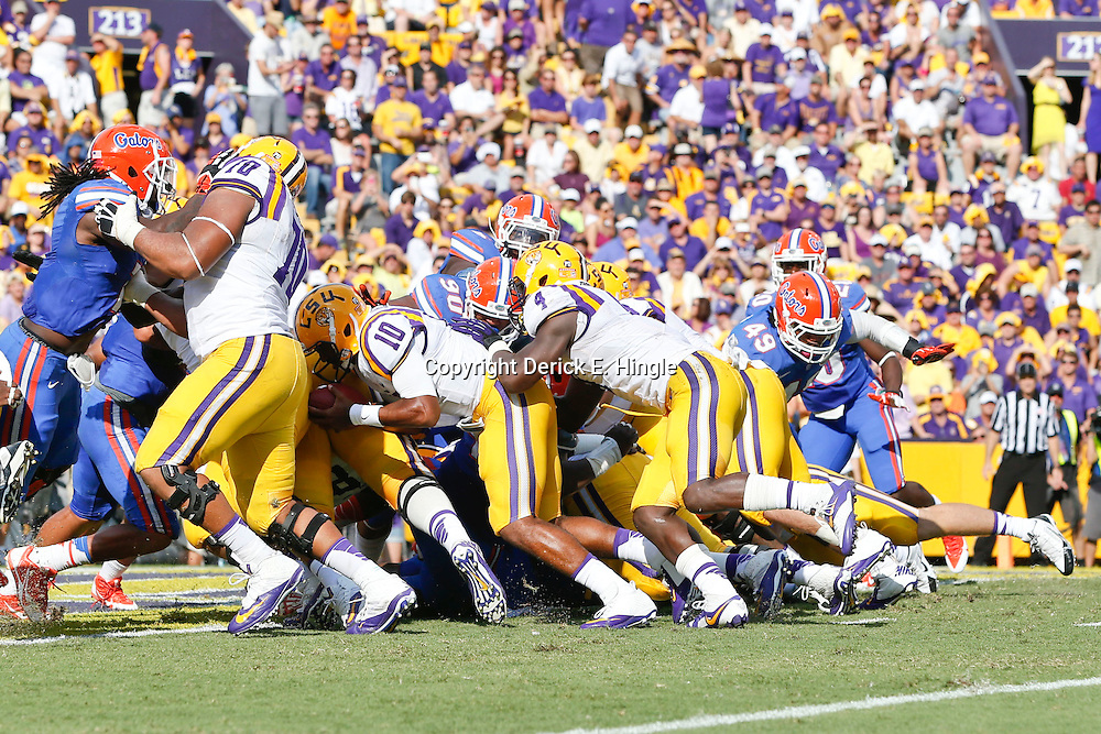 Oct 12, 2013; Baton Rouge, LA, USA; LSU Tigers quarterback Anthony Jennings (10) runs in for a touchdown against the Florida Gators during the second quarter of a game at Tiger Stadium. Mandatory Credit: Derick E. Hingle-USA TODAY Sports