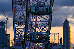 © Licensed to London News Pictures. 18/11/2019. London, UK. Visitors to the London Eye enjoy a sunset over the Thames towards Westminster Bridge and Vauxhall Cross as the Met Office issue a yellow weather warning for freezing fog with disruption to transport tomorrow as temperatures are set to tumble to -2 in the London area . Photo credit: Alex Lentati/LNP