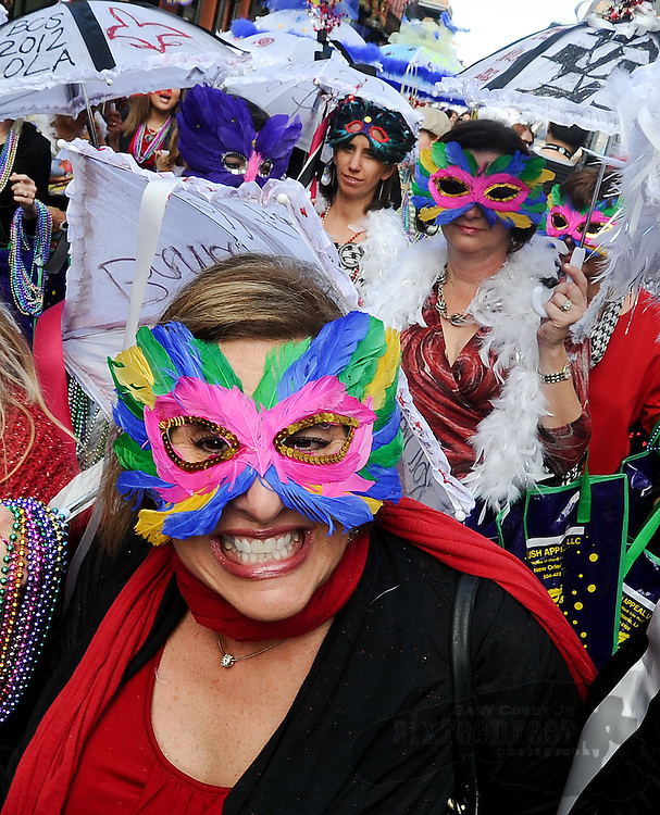Daily Photo by Gary Cosby Jr.    ..Alabama and LSU fans paraded through the French Quarter in a traditional Mardi Gras style parade with a band, umbrellas, masks and beads flying Saturday morning, January 7.  Lee Leleux is all smiles as she parades with the Bama faithful.  ..................................