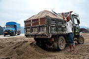 A truck is loaded with dredged sand in the town of Simaogangzhen, Yunan, China. The dredged sand is sold locally and to large scale construction sites in nearby major cities such as Kunming and Jinhong.