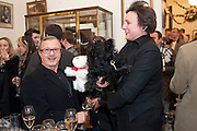 JACQUES AZAGURY WITH HIS TOY DOG; SELINA BLOW WITH HER DOG, Judith Watt's Dogs in Vogue BOOK LAUNCH. James Purdey and Sons. 57-58 S. Audley St. London.