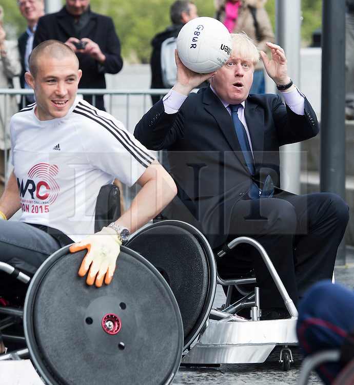 ***LNP BEST OF WEEK SELECTION*** © London News Pictures. 07/05/2013. London, UK. Mayor of London BORIS JOHNSON playing wheelchair rugby outside City Hall in London, while taking part in the launch of the World Wheelchair Rugby Challenge outside City Hall in London. Photo credit: Ben Cawthra/LNP