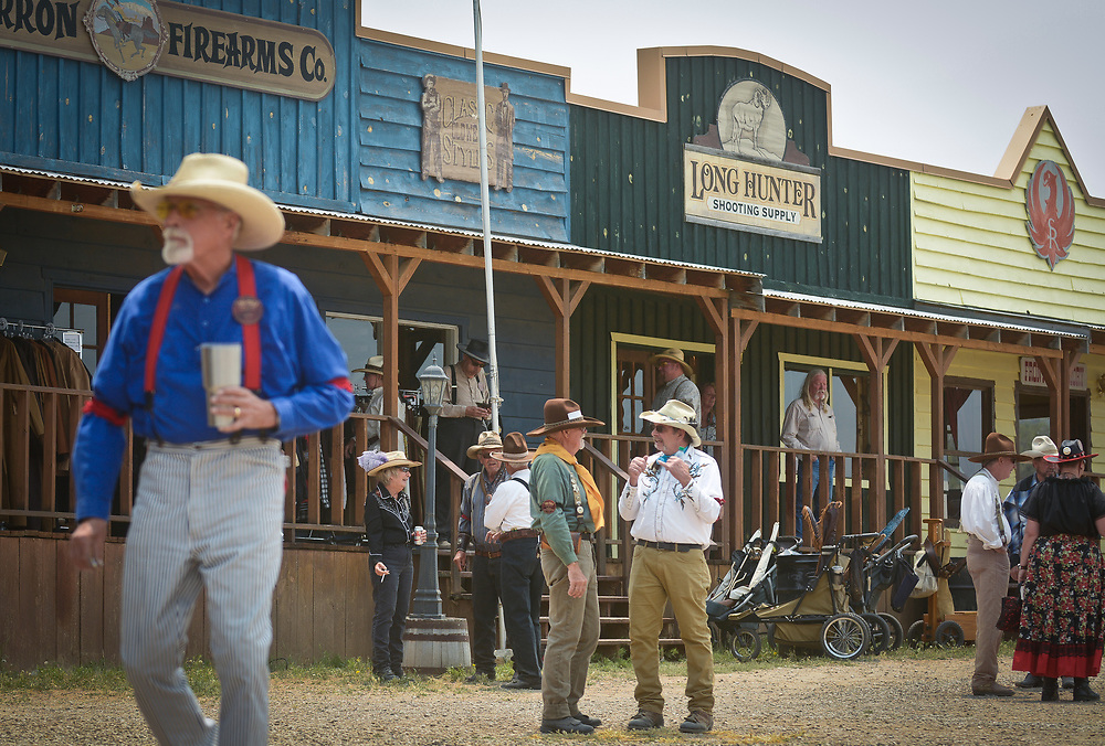 mkb062417h/metro/Marla Brose --  People mill around some of the stores at The World Championship of Cowboy Action Shooting, Saturday, June 23, 2017, at Founders Ranch in Edgewood,  N.M. About 600 shooters, all dressed in Old West-era attire, brought their pistols, rifles and shotguns to compete in the 36th annual shooting event at  Founders Ranch in Edgewood, N.M.  The public was welcome to watch on Friday and Saturday. The event ends on Sunday, a day which is closed to the public. (Marla Brose/Albuquerque Journal)