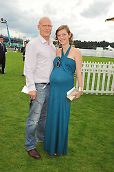 Actress CAMILLA RUTHERFORD and DOMINIC BURNS at the 25th annual Cartier International Polo held at Guards Polo Club, Great Windsor Park, Berkshire on 26th July 2009.