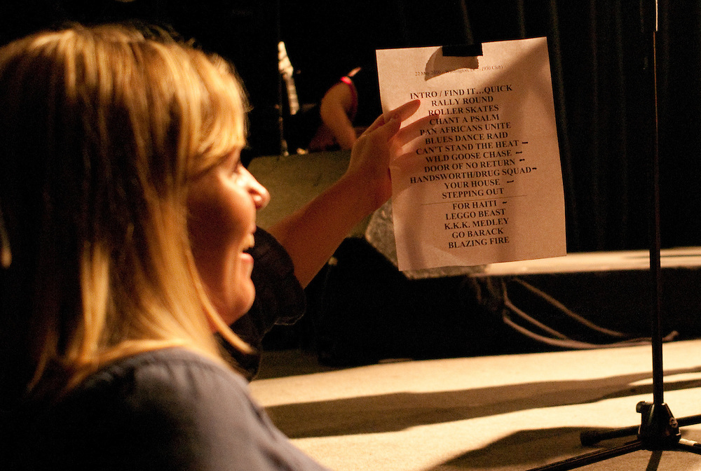 A fan holds up a set list for autographs at the end of the show.