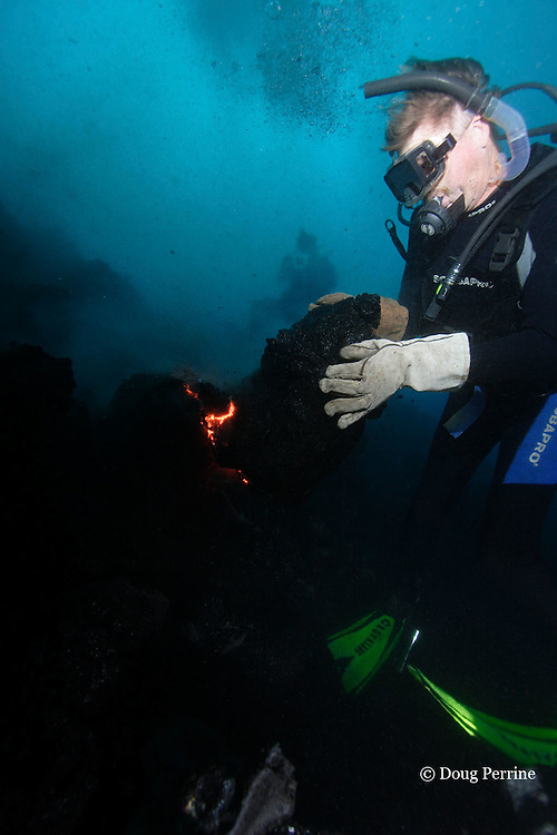 """diver Bud Turpin shapes erupting pillow lava by hand <br /> to form underwater lava sculptures at Kilauea Volcano, Hawaii Island ("""" the Big Island """"), Hawaii, U.S.A. ( Central Pacific Ocean ) MR 348"""