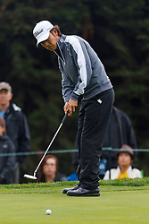 Feb 11, 2012; Pebble Beach CA, USA;  Kevin Na putts on the third whole during the third round of the AT&T Pebble Beach Pro-Am at Pebble Beach Golf Links. Mandatory Credit: Jason O. Watson-US PRESSWIRE