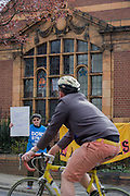 A campaigner asks a cyclist to hoot their support for the recently-closed Carnegie Library by Lambeth council in Herne Hill, south London as occupiers remain inside the premises on day 3 of its occupation, 3rd April 2016. The angry local community in the south London borough have occupied their important resource for learning and social hub for the weekend. After a long campaign by locals, Lambeth have gone ahead and closed the library's doors for the last time because they say, cuts to their budget mean millions must be saved. A gym will replace the working library and while some of the 20,000 books on shelves will remain, no librarians will be present to administer it.