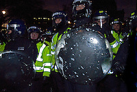 Riot police splashed with paint by Student protesters protesting government Education cuts Parliament Square London 11,12,10