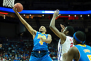 19 MAR 2015: Norman Powell (4) of University of California Los Angeles gets to the net against Yanick Moreira (2) of Southern Methodist University during the 2015 NCAA Men's Basketball Tournament held at the KFC Yum! Center in Louisville, KY. UCLA defeated SMU 60-59. Brett Wilhelm/NCAA Photos