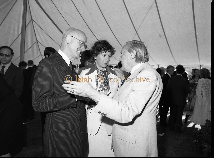 Guests and staff at the US Embassy in Phoenix Park, Dublin, celebrate American Independence Day..1980-07-04.4th July 1980.04/07/1980.07-04-80..Photographed at the US Ambassador's Residence,  Phoenix Park...US Ambassador William V Shannon and his wife Elizabeth McNelly Shannon chat  with a guest in the marquee during festivities.