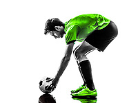 one soccer football player young man preparing free kick in silhouette studio on white background