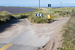 New road replacing old road suffering from erosion at Spurn Head; East Yorkshire; England