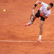 PARIS, FRANCE June 08.  Novak Djokovic of Serbia in action against Dominic Thiem of Austria on Court Philippe-Chatrier during the Men's Singles Semifinals match at the 2019 French Open Tennis Tournament at Roland Garros on June 8th 2019 in Paris, France. (Photo by Tim Clayton/Corbis via Getty Images)