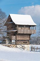Old Swiss wooden farm house in Hamikon, Switzerland in the snow.