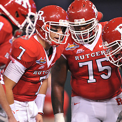 Dec 19, 2009; St. Petersburg, Fla., USA; Rutgers quarterback Tom Savage (7) calls the play in the huddle during NCAA Football action in Rutgers' 45-24 victory over Central Florida in the St. Petersburg Bowl at Tropicana Field.