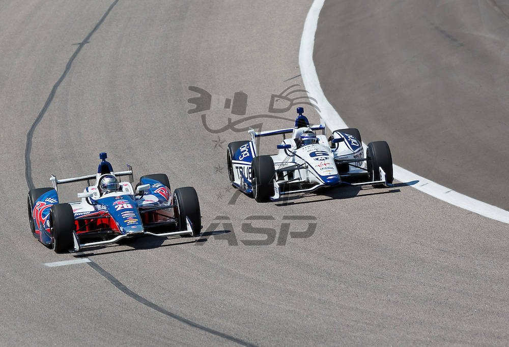 Ft WORTH, TX - JUN 08, 2012: Marco Andretti (26) and Katherine Legge (6) prepare to qualify for the Firestone 550 race at the Texas Motor Speedway in Fort Worth, TX.