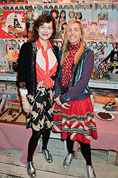 Left to right, JASMINE GUINNESS and HONEY BOWDREY at a promotional party for the A Girl For All Time doll held at HoneyJam, 2 Blenheim Crescent, London on 5th December 2015.