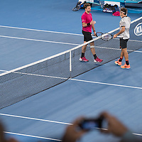 Stan Wawrinka and Roger Federer of Switzerland on day eleven of the 2017 Australian Open at Melbourne Park on January 26, 2017 in Melbourne, Australia.<br /> (Ben Solomon/Tennis Australia)