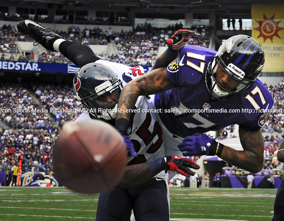 Sept. 22, 2013 - Baltimore, MD, USA - Houston Texans' Kareem Jackson, left, is called for defensive-pass interference on Baltimore Ravens wide receiver Tandon Doss, right, during the third quarter in Baltimore, Maryland, on Sunday, September 22, 2013. The Ravens defeated the Texans, 30-9