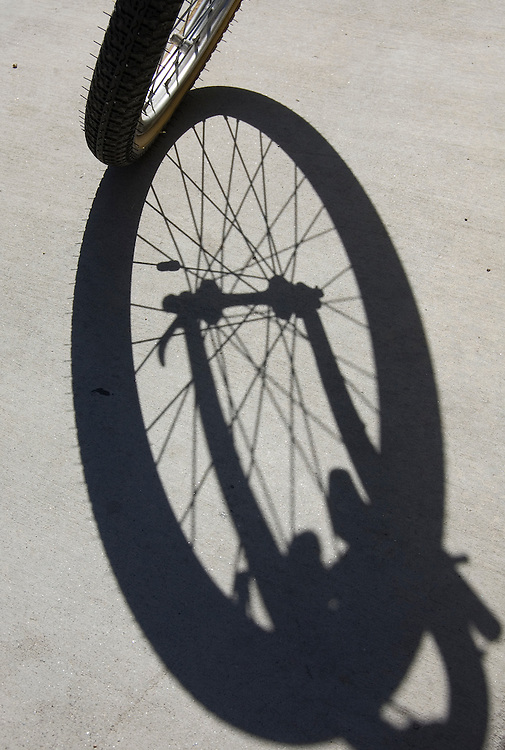 Mountain bike wheel and shadow, front view. Bike-tography by Martha Retallick.
