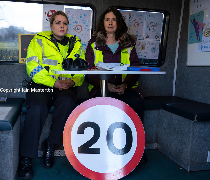 Edinburgh, Scotland, UK. 14 March, 2019. Police checking car speeds in Edinburgh at the first in a series of pilot 20mph 'Roadside Education' events, held in partnership with Police Scotland, aiming to raise awareness of the consequences of breaking 20mph speed limits. Speeding drivers will be stopped by Police Officers and offered a short driver education session in a Police Command Unit. This will involve Edinburgh Council Transport Officers, who will remind drivers of their speed, advising of the potential consequences of their actions and the impact this can have on the severity of a collision. Drivers will then be shown a short video featuring Edinburgh school children who asked the Council to help them reduce speeds around their school. Pictured; L, community police officer PC Matheson and R, Edinburgh City Council Project Officer Eileen Hewitt.