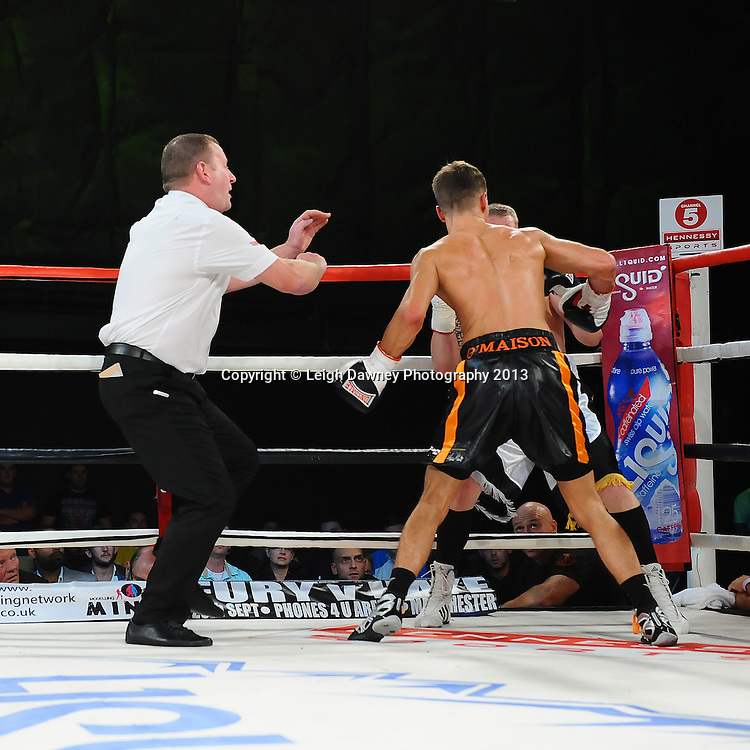Sam O'Maison (black shorts) defeats Martin Shaw after the referee stopped Saturday 14th September 2013 at the Magna Centre, Rotherham. Hennessy Sports. Self billing applies. © Credit: Leigh Dawney Photography.