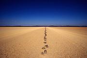 Stones marking the desert road in Djibouti
