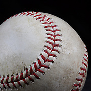 An authentic Rawlings used baseball from the 2012 Major League Baseball season showing the red stitching and markings. 16th May 2012. Photo Tim Clayton
