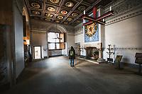 Woman takes in one of many rooms at Edinburgh Castle, in Edinburgh, Scotland. Copyright 2019 Reid McNally.