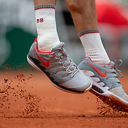 PARIS, FRANCE May 26. The feet of Roger Federer of Switzerland serving against Lorenzo Sonego of Italy on Court Philippe-Chatrier in the Men's Singles first round match at the 2019 French Open Tennis Tournament at Roland Garros on May 26th 2019 in Paris, France. (Photo by Tim Clayton/Corbis via Getty Images)