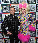 """Showbiz Spitfire"" Paige Turner, right, and Patrik Gallineaux, LGBT Ambassador for Stoli, co-host the launch of The 3rd Annual Stoli Key West Cocktail Classic competition in New York, Wednesday, Feb. 24, 2016, at Boxers HK.  (Diane Bondareff/Invision for Stoli Vodka/AP Images)"
