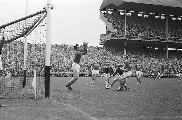 Kerry goalie J Culloty picks the ball from the air as Galway send it flying goalwards in the first half during the All Ireland Senior Gaelic Football Championship Final, Kerry vs Galway in Croke Park on the 27th September 1964. Galway 0-15 Kerry 0-10.