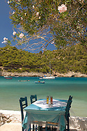 Waterside table and chairs at a taverna in Asos, Kefalonia, Greece