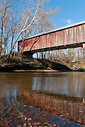 Cox Ford Covered Bridge was built in 1913 in Burr Arch style by J.A. Britton over Sugar Creek. A roof and red painted wood sides protect this historic bridge in Turkey Run State Park, in historic Parke County, Indiana, USA.