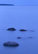 Rocks in Lake Winnipeg at dawn, Hecla Provincial Park, Manitoba, Canada