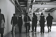 Two officers along with a fireman and others walk through the hall, 10 Years of Scum Tek, Mansfield Road, Belsize Park, London, UK, 8 August, 2015