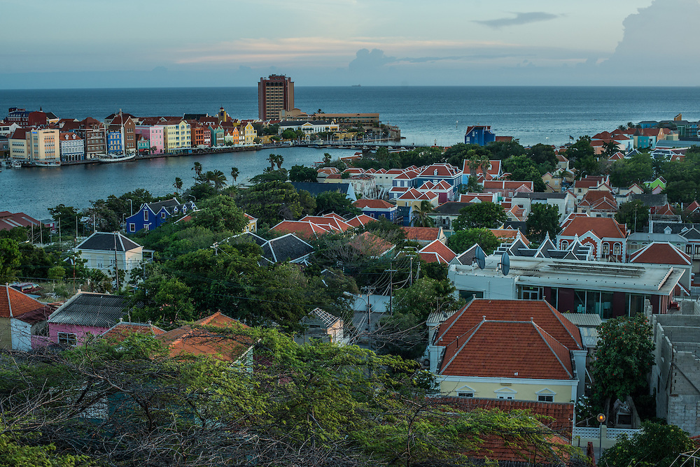 "WILLEMSTAD, CURAÇAO - OCTOBER 23, 2016: Curaçao, along with Aruba and Colombia and Brazil, are countries receiving a spike in undocumented migrants from Venezuela. The small Caribbean islands neighboring Venezuela say they simply cannot absorb the onslaught. The closest to Venezuela's coast, Aruba and Curaçao, have effectively sealed their borders to poor Venezuelans since last year by making them show $1,000 in cash before entering — the equivalent of more than five years of earnings in a minimum wage job. Both countries have increased patrols and deportations, and Aruba has even set aside a stadium to hold as many as 500 Venezuelan migrants after they are caught. It's a dramatic reversal of fortune for Venezuelans, who once went to Curaçao to spend money as tourists, not to plead for work.  But perhaps most startling are the Venezuelans now fleeing by sea, an image so symbolic of the perilous journeys to escape Cuba or Haiti — but not oil-rich Venezuela. ""It has all totally changed,"" said Ivan de la Vega, a sociologist at the Central University of Venezuela. He added that about 160,000 Venezuelans have fled the country in the last year alone, about 60 percent more than the number who left the year before. ""The earnings of these people are low,"" Mr. de la Vega said of the recent migrants. ""The only option left to them is the nearby countries, ones they can get to on foot, or by rafts, or go on boats with tiny motors."" Inflation will hit a mind-boggling 1,600 percent this year, the International Monetary Fund estimates, shriveling salaries and creating a new class of poor Venezuelans who have abandoned professional careers for precarious lives abroad. PHOTO: Meridith Kohut for The New York Times"