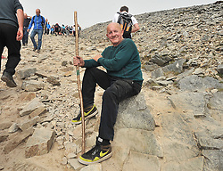 Taking a breather......Gerry McLoughlin Barnatra from Bellmullet Co Mayo pictured on his way to the summit of Croagh Patrick yesterday.<br /> Pic Conor McKeown