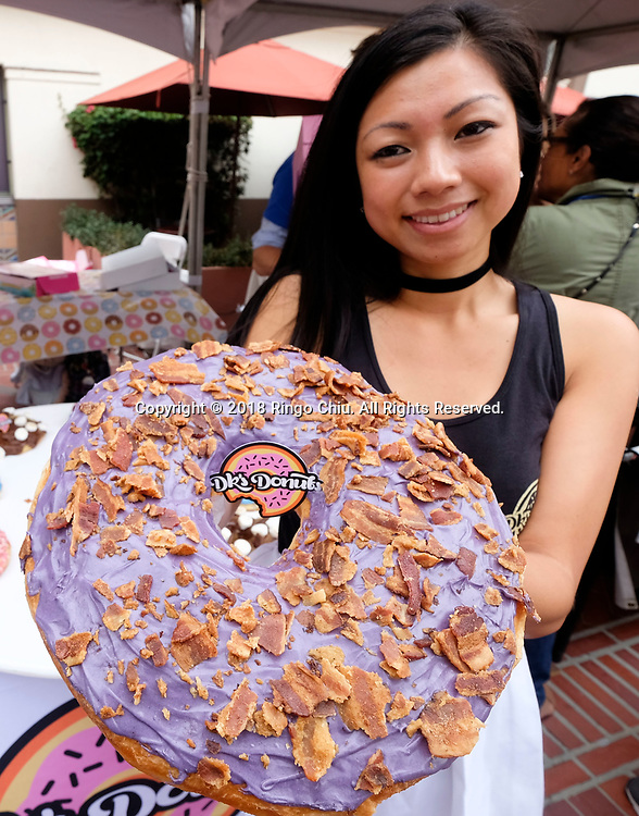 An vendor owner shows their giant donut at the inaugural DTLA Donut Festival at Union Station in Los Angeles on Saturday, June 16, 2018. (Photo by Ringo Chiu)<br /> <br /> Usage Notes: This content is intended for editorial use only. For other uses, additional clearances may be required.