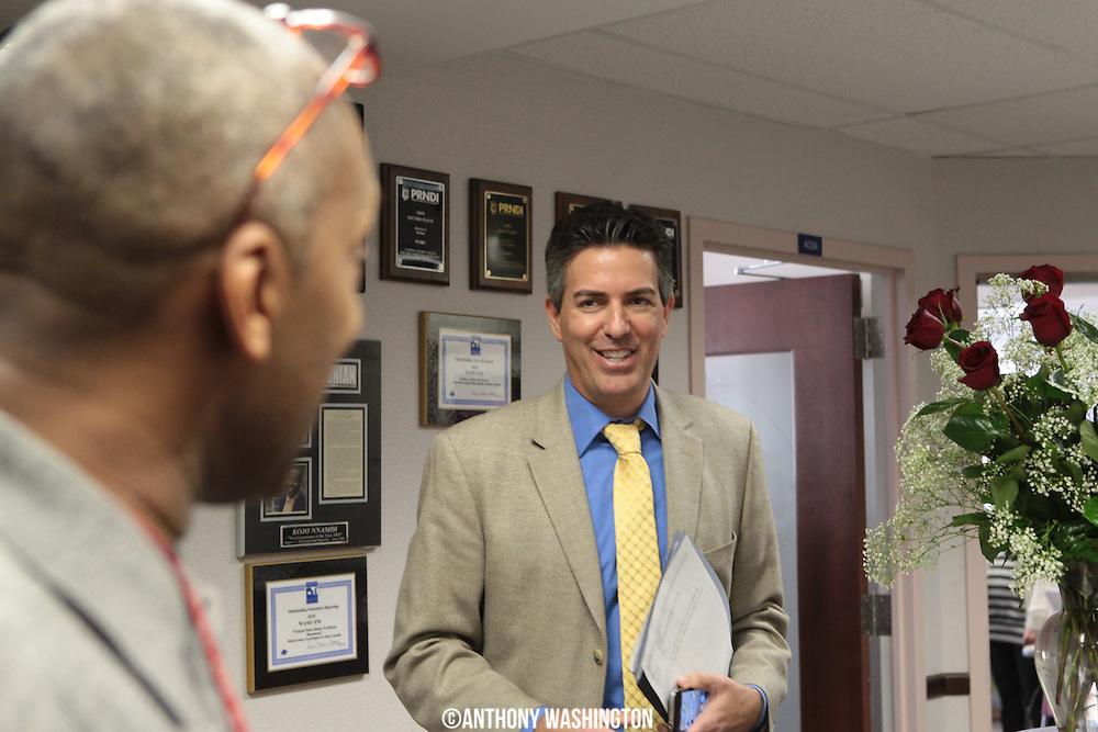 Managing producer of <i>The Animal House</i>,Steve Williams (L), talks with Wayne Pacelle (R), President and Chief Executive Officer of The Humane Society of the United States, in the receptionist area of WAMU 88.5 during the fifth day of the winter membership campaign on Wednesday, February 15, 2012 in Washington, DC.