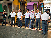 11 JULY 2011 - BANGKOK, THAILAND:    Conductors of the State Railways of Thailand wait to board their train in Hua Lamphong station in Bangkok. Hua Lamphong Grand Central Railway Station, officially known as the Bangkok Grand Central Terminal Railway Station, is the main railway station in Bangkok, Thailand. It is located in the center of the city in Pathum Wan District, and is operated by the State Railway of Thailand. The station was opened on 25 June 1916, after six years' construction. The station was built in an Italian Neo-Renaissance style, with decorated wooden roofs and stained glass windows. The architecture is attributed to Turin-born Mario Tamagno, who, with countryman Annibale Rigotti made a mark on early 20th century public building in Bangkok. The pair also designed Bang Khun Prom Palace (1906), Ananda Samakhom Throne Hall in The Royal Plaza (1907-15) and Suan Kularb Residential Hall and Throne Hall in Dusit Garden, among other buildings..There are 14 platforms and 26 ticket booths. Hua Lamphong serves over 130 trains and approximately 60,000 passengers each day. Thailand has the most advanced rail system in Southeast Asia and trains from Hua Lamphong serve all corners of the Kingdom.      PHOTO BY JACK KURTZ