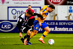 Ethan Robson of Grimsby Town puts pressure on Alex MacDonald of Mansfield Town - Mandatory by-line: Ryan Crockett/JMP - 04/01/2020 - FOOTBALL - One Call Stadium - Mansfield, England - Mansfield Town v Grimsby Town - Sky Bet League Two