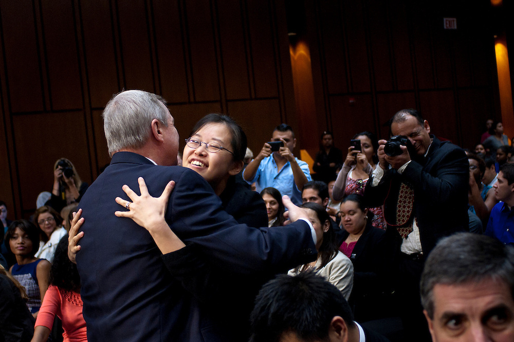 """Senator DICK DURBIN (D-IL) greets TEREZA LEE before a Senate Judiciary Committee hearing on """"The DREAM (Development, Relief and Education for Alien Minors) Act."""" Ten years ago LEE had been accepted into several of the country's most prestigious music conservatories. But her parents had brought her to the United States when she was two, and she was undocumented. That spurred DURBIN to begin work on the DREAM Act ten years ago."""