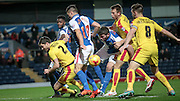 Lewis Buxton (Rotherham United), Lee Frecklington (captain) (Rotherham United), Ben Mars (Blackburn Rovers) and Grant Hanley (captain) (Blackburn Rovers) all tussle for the ball during a corner during the Sky Bet Championship match between Blackburn Rovers and Rotherham United at Ewood Park, Blackburn, England on 11 December 2015. Photo by Mark P Doherty.